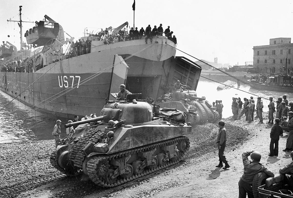 sherman tanks unloading from a boat